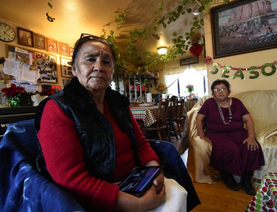 Clara Daye, left, and younger sister Rose M. Zunie, speak about Clayton Homes Sunday, Dec. 6, 2015, at their home in Fallen Maple Canyon, which is located 3 miles south of Pine Dale, N.M. Daye says a Clayton Homes salesperson told her, her bank would not be able to finance a mobile home for her, that they only financed through their own finance company. (Photo by Donovan Quintero)